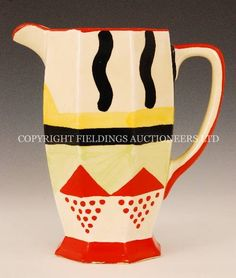 Sunspots - A large Clarice Cliff Athens shape jug circa 1931 hand painted with wave lines, triangles and spots in red, black, yellow and green with red banding sold at Fieldings Auctioneers for £3,050 www.fieldingsauctioneers.co.uk