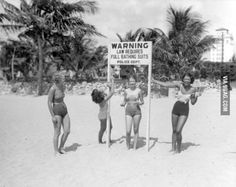 Young Women Making Fun of Sign at Beach, Miami, Florida, 1934