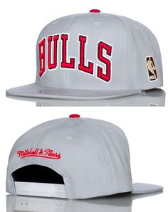 MITCHELL AND NESS Basketball cap Embroidered team logo on front Adjustable strap for comfort