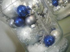 Using ball ornaments is a good idea...you could use blue and silver in the fish bowls...