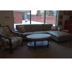 Leather sectional with a right facing chase, ottoman and chair in fabric.