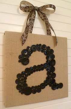 Letter- I really like this. Burlap covered canvas, buttons, and ribbon!