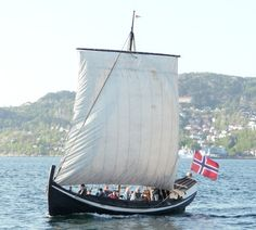 A traditional Norwegian clinker built boat with a square sail photographed off Bergen in 2010.