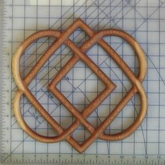 For tattoo ... Add dots throughout symbolizing members in family ... as seen in mothers knot... Knot of Four Hearts-Celtic Wood Carving-Family Love Knot... maybe one day