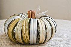 Brilliant use of old canning jar lids. http://www.simplyklassichome.com/2012/09/canning-jar-lid-pumpkin.html
