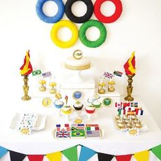 Looking for Olympic party inspiration? This amazing table from @birdsparty on HWTM is our absolute favorite! Those flag cookies are seriously lovely! #olympics #gymnastics #rio #goteamusa #cookies #parties #decoratedcookies #fun