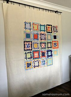 Curtain rail to hang quilt layouts.