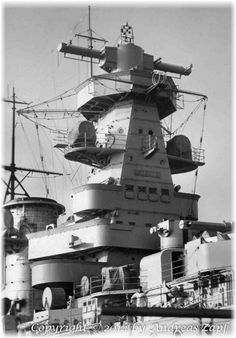 Bridge structure of 11 in 'pocket battleship' Admiral Graf Spee, scuttled after the Battle of the River Plate in December 1939. The plaque reads 'Coronel' after the Admiral's famous 1914 victory. This type of tower was later removed from sister Admiral Scheer in favour of a stepped platform design, as it was found to catch the wind badly. The first ship of the class (Deutschland / later Lutzow) was built with such a design anyway.