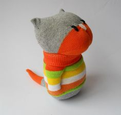 toy stuffed animal sock animal cat kitten sock creature orange