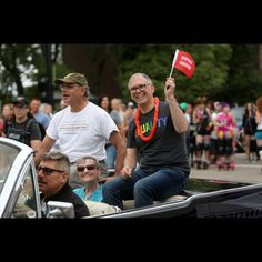 Jim Obergefell smiles and holds up an equality flag while riding in the Cincinnati Pride Parade with his attorney, Al Gerhardstein, and Paulette Roberts, aunt of his late husband, John Arthur on Saturday, June 27. Obergefell is the named plaintiff in the Obergefell v. Hodges Supreme Court case that legalized same sex marriage nationwide. The Enquirer/Amanda Rossmann.