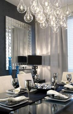 Add sophistication to your dinning room with touches of dark colors, mirrored furniture and unique lighting.