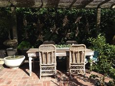 Grab a seat! Wonderful garden table, live the wicker stars hanging as decoration!