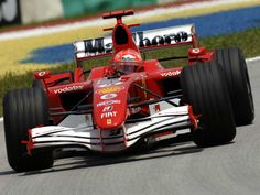 Michael Schumacher (Ferrari 248 F1) 2006 Sepang #F1 (P6, with the cars' flexing wings provoking concern)