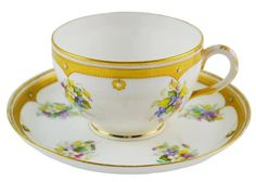 Gold rimmed tea cup and saucer.
