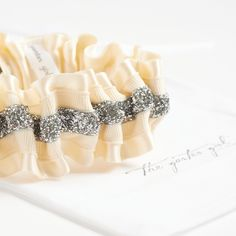 Something sparkly! This modern wedding garter hand made by The Garter Girl is so fun and flirty!