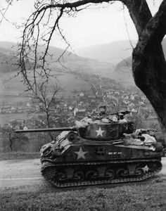 """In a kinetic image, a U. Army Armored Division Sherman medium tank nicknamed """"WAS IST DAS"""" (""""What is that"""" in German) races through Schneeberg, Germany Army Vehicles, Armored Vehicles, Military Photos, Military History, Tank Wallpaper, V Force, Sherman Tank, Military Armor, Tank Destroyer"""