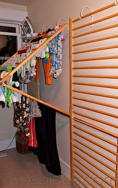 DIY wall drying rack † Baby gates into laundry drying racks. Now THIS is totally clever! I think this would work SO well, perfect use of old baby gates, and with a minimum of effort. Really genius – I need this! Wall Drying Rack, Drying Rack Laundry, Clothes Drying Racks, Laundry Room Organization, Laundry Storage, Wall Storage, Diy Storage, Diy Organization, Laundry Rooms