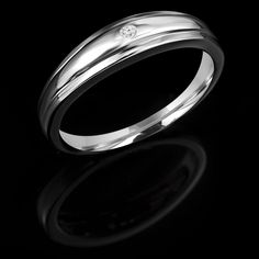 This Diamond Wedding Band Ring maintains the traditional band style, with a lovely diamond to enhance the look. Simply beautiful #weddingband #diamond