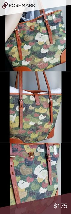 """Dooney & Burke Camouflage Duck Tote DY055 GR Dover Tote. Made of high quality PVC with leather trims, handles and shoulder strap.One inside zip pocket. Two inside pockets. Cell phone pocket. Inside center zip compartment. Inside key hook.Adjustable strap. Strap drop length 11.75"""".Lined. Feet. Turn lock closure. H 12"""" x W 6.75"""" x L 16 Dooney & Bourke Bags Totes"""