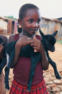 Plan Canada:  Buy a goat for a family in need.  It comes with training, animal shelters and vet access.