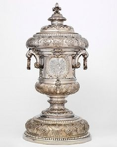 Fine Fountain by Pierre Plate, 1713. H: 64cm, W: 41.4cm, 12.8kg. This wine fountain would have been prominently displayed on a sideboard. It was used to rinse wine glasses before they were refilled to guests at the dining table. The maker, Pierre Platel, was a prestigious Huguenot goldsmith to whom Paul de Lamerie, later the most successful smith in London, was apprenticed. Victoria & Albert Museum.