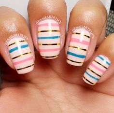 Multi-striped pink nails. (@nailartbyjen on Instagram)
