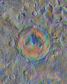 Gale crater as seen by Mars Odyssey orbiter Gale Crater, home to NASA's Curiosity Mars rover, shows a new face in this image made using data from the THEMIS camera on NASA's Mars Odyssey orbiter. The colors come from an image processing method that identifies mineral differences in surface materials and displays them in false colors.