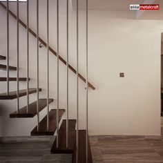 This delightful open tread stair is constructed from, Stainless Steel and American Walnut. A simple but very effective concept of hanging the outer ends of the treads from the ceiling allows the delicate slim line look to this staircase, yet ensuring