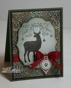 handmade card: Vintage Christmas Deer ... gorgeous example of faux patina on the background of this card .... like the edge treatment of the main die cut label ... dark coloring on edge, some soft sponging and piercing ... great card!!