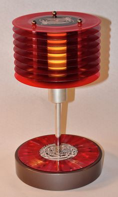 THIS is on track...colored vinyl 45 record lamp. $250.00, via Etsy.