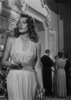 Rita Hayworth in Gilda wearing a belt and bracelet made by Joseff of Hollywood.