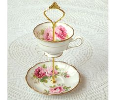 """Pink Roses Jewelry Stand - Fresh from an English garden in full bloom comes this sweet 2-tiered jewelry stand. Lush pink roses and rich gold details stack up in a petite pedestal created from a vintage cup & saucer set in Royal Albert's """"American Beauty"""" pattern."""