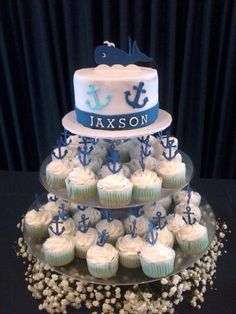 Navy Theme Baby Shower - 6 inch cake with butter cream and mmf accents. 2 dozed cupcakes with butter cream and anchor toppers For some nautical baby shower decorations go to: http://modernbabyshowerideas.com/nautical-baby-shower