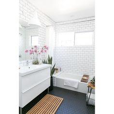 All white bathroom with black penny tiles for monochrome look. #rumahkubathroom