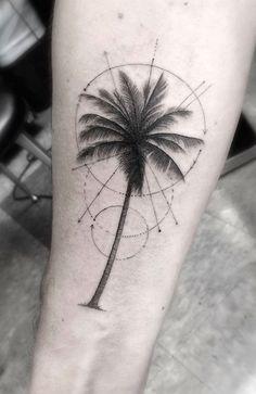 Le tatouage d'un palmier graphique et géométrique
