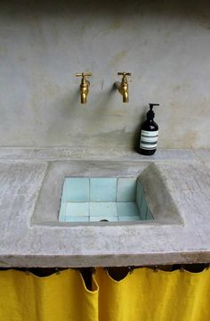 Simple sink:  that aqua tile in the kitchen sink is so beautiful, almost makes it look like a pool even when there isn't any water in it.  And then with the yellow curtain, nice pop!