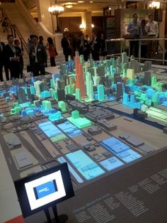 Projectors display Chicago city data on a physical model of the city. Interactive key allows users to filter out certain data and view different perspectives on the city. Interactive Table, Interactive Exhibition, Exhibition Display, Interactive Design, Exposition Interactive, City Model, Projection Mapping, Web Design, Expositions