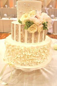 Lovely unique three tier white wedding cake; Via Sugarbelle Cakery