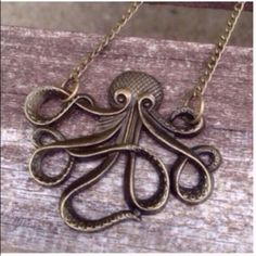 """Kraken Necklace Super cute antique bronze necklace. Chain is about 25"""". New in package. Jewelry Necklaces"""
