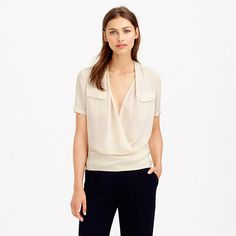 """Our designers spent months tweaking the design of this top to get the draping just right (and by """"just right,"""" we mean absolutely perfect). Part popover, part utility shirt and totally luxe, it's made from silk georgette and finished with a sleek crossover front and a subtly pleated collar. <ul><li>Body length: 25"""".</li><li>Silk.</li><li>Chest pockets.</li><li>Dry clean.</li><li>Import.</li></ul>"""