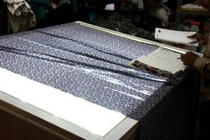 STEP 2. The fabric is then measured in the scale per metre and the quality is checked in the fabric checking machine and also by the merchant.