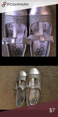 Girls size 10 silver dress shoes Good condition girls dress shoes! Easy Velcro closure. Slight fading on the toe as shown in picture! Children's Place Shoes Dress Shoes