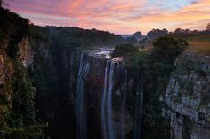 Landscape photo of a waterfall plunging into a deep, narrow gorge Landscape Photos, Waterfalls, South Africa, Sunrise, Coast, Ocean, Deep, Explore, Mountains