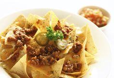 Serve in bowls with traditional toppings, or add the turkey chili to tortilla chips, melt cheese on top.
