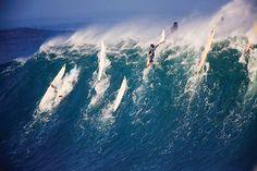 Incredible waves: Surfers at Waimea Bay in Hawaii