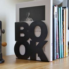 Modern stylish bookend BookOne black or white powder coated laser cut metal thick enough to hold books. €19.00, via Etsy.