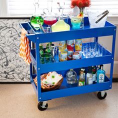 Weird Science  Yes, this is a metal tool cart typically used in the garage! The brilliant color and low price, along with heavy-duty wheels and capacity for bearing the weight of a fully-stocked bar, make this an inventive choice. We continued the quirky theme by using lab equipment mixed with modern decanters that look straight out of chemistry class.