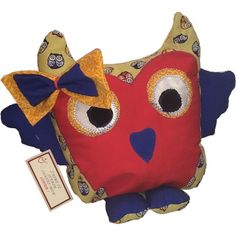 Coussin hibou décoratif coloré et exclusif, cadeau idéal pour enfant, dans les teintes de doré, orange, rouge et bleu