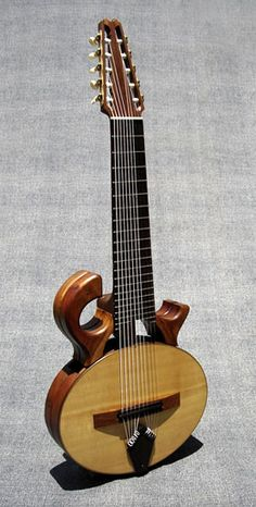 Mervyn Davis Smoothtalker 10-string classical guitar - I actually got to play one of these a few years back (but it was a steel string version) when I first met the amazing south african guitarist Tony Cox, Reallllly cool instrument and I'd love to hear the nylon version! http://ClassicalGuitarTraining.com