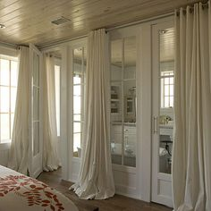 Long Drapery - Style Guide: Bedroom Window Treatments - Southernliving. Full-length drapery panels that pool on the floor look luxurious and elegant.
